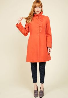 Ruffle Your Weathers Coat in Squash. What better way to celebrate the arrival of chilly days than in the majesty of this rich orange coat from Canadian brand Pink Martini? #orange #modcloth