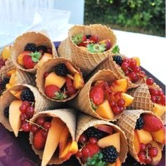 Nice idea for Thanksgiving, ice cream cones with fruit inside