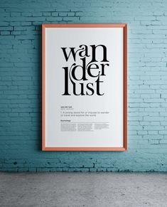 Framed wanderlust poster on a blue wall