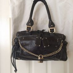 """2XHP! %Auth Chloe Paddington Capsule Handbag 100% Authentic Chloe Paddington Capsule Handbag Color: Black Gray Material: Leather  Approximately 8.5""""H x 14.5""""W x 7""""D w/ 8"""" Drop Handles. Topstitching with light gold-tone hardware & signature padlock ornaments. Also has a double top zip (which are in silver) with leather Chloe tag pulls. Interior features single slip pocket and a zippered pocket. The outside flap pocket has a hidden magnetic closure and protective feet on bottom. Dust bag…"""
