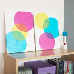 Check your gift wrap drawer for tissue paper in vibrant colors. With the help of mod podge and white acrylic paint, whimsical wall art with a circular motif can be yours!