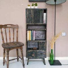 The pine cupboard, but not in distressed black, raw wood instead. It could be stained and the back panel could be painted some other color, maybe a nice red to contrast the dark wood stain. Perfect for my narrow hallway.