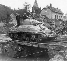 M4A1 Sherman Tank of the 741st Tank Battalion, attached to 2nd Infantry Division., U.S. First Army, crosses an improvised bridge in Germany, 9 March 1945...
