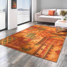 Orangefarbener Orientteppich im Patchwork-Design