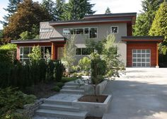 modern exterior by Portal Design Inc  solving the problem of needing a walkway next to a driveway