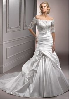 I love the fact that it has sleeves. It's not often you see a wedding dress with sleeves that actually looks good.