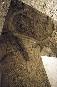 "Sardinia- Bonorva, part of the necropolis ""Domus de janas"". Tomb 3. Image of a pillar decorated with a bull's head and spirals."