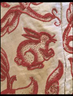 Crewel work on cotton and linen twill ground; stem stitch with long, short and coral stitches and French knots 1630's V & A Museum