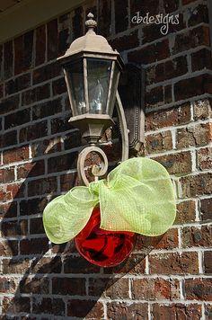 Cute simple decoration for lights beside the garage door.