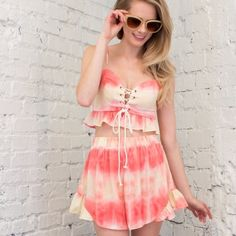 Two piece ruffle top & short set. Price firm. So cute!! Must have for summer! Two piece ruffle top and short set. Lace up front. Ruffle detail. 100% rayon. Seriously adorable! April Spirit Other