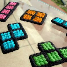 plastic canvas tetris magnets - so you can waste time on the fridge AND on the gameboy.