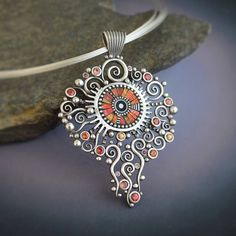 Big Silver Solstice Necklace Pendant Statement piece with red and orange sapphires sterling silver beads iridescent  polymer inlay. $1,990.00, via Etsy.
