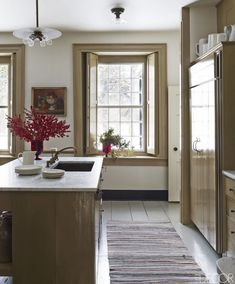 """Celia Barbour, """"Living History: The 1786 Home of Peter Spears and Brian Swardstrom in Claverack, New York,"""" Elle Decor (December 2014): 112–19. The trim and cabinetry are painted in Farrow & Ball's Buff."""