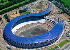 Construction is finished for Japanese architect Toyo Ito's Solar Powered Stadium in Taiwan. The stadium's roof is covered by solar panels. Stadium Architecture, Architecture Cool, Conceptual Architecture, Sustainable Architecture, Sustainable Design, Toyo Ito, Solar Energy, Solar Power, Renewable Energy