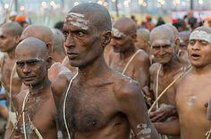 Walking back to the Akhara as part of the initiation of new sadhus during Kumbha Mela festival - stock image