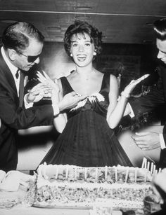 Frank Sinatra smears birthday cake on actor Natalie Wood's dress at a surprise party given by Sinatra to honor Wood's twenty-first birthday at Romanoff's in Hollywood, California, July 20, 1959.