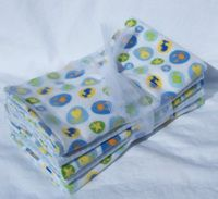 DIY burp cloths without using cloth diapers. Idea: use old receiving blankets for the softness and extra absorbency.