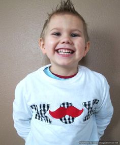'Stache Top Cut out and appliqué a mustache onto appliquéd XOXO for a boyish Valentine's Day top. Spotted at Just Sew Sassy