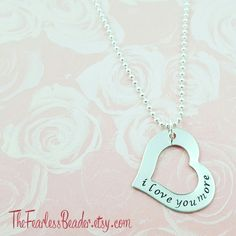 I love you more!  The perfect anniversary gift or present for a mom or daughter. Choose which chain style you'd like and if you'd like to customize the phrase or add a date or initials.