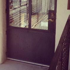 Limestone & Boxwoods - Instagram (@limestonebox) - Steel door with rivets