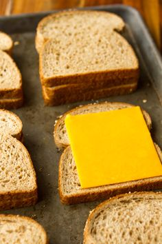 Grilled Cheese in the Oven -- this simple method makes 6 classic grilled cheese sandwiches per half sheet pan, hot and fresh from the oven, in just about 10 minutes! | via @unsophisticook on Unsophisticook.com