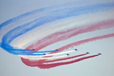 Red, white & blue colored smoke from a very patriotic air show.