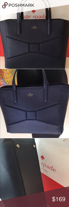🆕KATE SPADE NEW LEATHER SHOULDER TOTE 💯AUTHENTIC KATE SOADE NEW WITH TAGS NEVER USED PEBBLE LEATHER VERY DADK NAVY SHOULDER TOTE 100% AUTHENTIC. SO STUNNING AND STYLISH. PERFECT FOR ANY OCCASION AND TOTALLY ON TREND. WHAT A AMAZING BAG WITH METAL FEET ON BOTTOM . VERY ROOMY BAG WITH THREE LARGE INTERIOR WALL POCKETS. THE BAG MEASURES 14.5 INCHES WIDE BY 10 INCHES TALL AND NICELY DEEP TO FIT YOUR NEEDS. THE SHOULDER/ HANDLES HAVE A 5 INCH DROP kate spade Bags Shoulder Bags