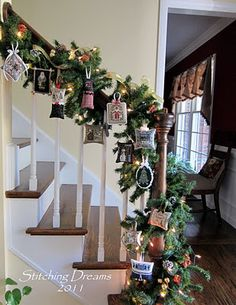 Stitching Dreams: 2011 Christmas Ornaments displayed on banister - nice display idea