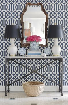 Kelly Wearstler Imperial Navy Trellis wall paper, iron console table, white lamps
