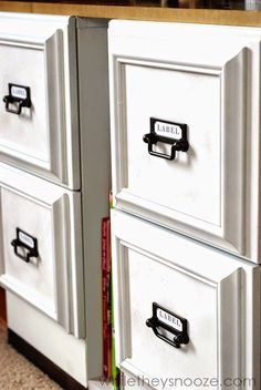 Transform old filing cabinets into great looking storage drawers; repurposed. Glue old wooden picture frames to each drawer front and paint all matching color; by While They Snooze Blogspot.