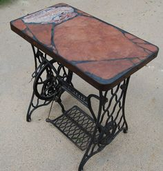 Singer 166: A natural stone topped table featuring a sewing | Etsy Sandstone Slabs, Steel Rims, Accent Tables, Make Arrangements, Outdoor Furniture, Outdoor Decor, Recycled Materials, Cast Iron, Natural Stones