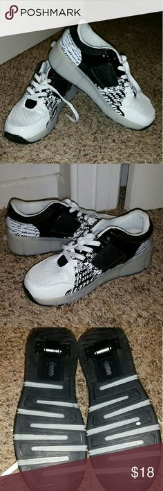 Heeleys light up shoes Never been worn size 7 in men or about an 8 and 1/2 in women Wish Shoes Sneakers