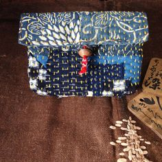 This Pouch is made from 7 antique Japanese BORO, Furoshiki whose base is 19th century indigo dyed cotton Kimonos. Very lovely detail of a