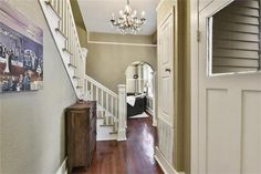 8324 Spruce St, New Orleans, LA 70118 chandelier arch staircase