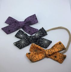 Fun and adorable Halloween hair bows and nylon headbands! These bows come in the style I like to call my medium knot bow. They are the perfect accessory to any outfit!  Colors available: Black, Orange, and Purple Available in either an alligator clip or soft nylon headband. Headbands cost .50 extra.