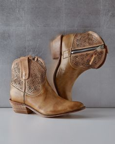 Call it urbane cowboy — the delicate laser-cut detail of these short leather boots is a chic way to do Western. Particularly dashing with a skirt or dress, so that the handiwork is on full display. Short Cowboy Boots, Cowboy Boot Outfits, Ankle Cowboy Boots, Short Boots, Western Boots, Fancy Shoes, Me Too Shoes, Women's Shoes, Over Boots
