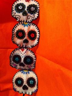 sugar skulls .  This cute sugar skull is hand painted and hand stitch. It's attached to a black headband it can also be attached to a stretchy band.   Listing is for 1 headband picked at random.