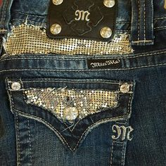 Miss Me Jeans Super cute boot cut jeans with silver embellishments on rear pockets and front right pocket. Miss Me Jeans Boot Cut