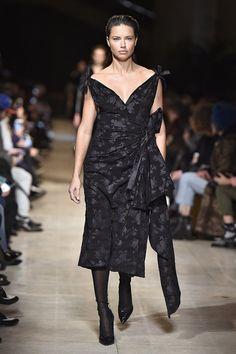 Adriana Lima walked Miu Miu's Fall '16 show at Paris Fashion Week on March 8, closing the season in an all-black, superfeminine ensemble.