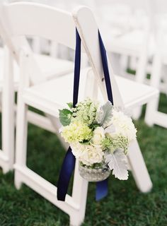 Thinking about something similar for the aisle decorations - white/cream/green flowers with succulents