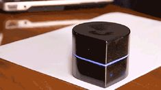 A pocket sized printer that moves itself across the page