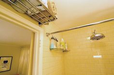 Train racks over bathroom door for towel storage/hanging