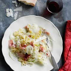 Bow-Tie Salad with Fennel, Prosciutto, and Parmesan | A tangy lemon dressing makes this main-course salad especially refreshing, and the only thing you have to cook is the pasta. If you find a fennel bulb with the dark-green feathery tops still on, chop some of them and toss into the pasta.