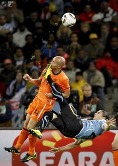 Mike Hutchings, a Reuters photographer based in South Africa, has won the 1st Prize Sport Single category with this picture of Netherlands' Demy de Zeeuw being kicked in the face by Uruguay's Martin Caceres during their World Cup semi-final in Cape Town, taken July 6. The prize-winning entries of the World Press Photo Contest 2010, the world's largest annual press photography contest, were announced February 11, 2011. REUTERS/Mike Hutchings