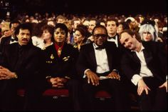 Lionel Richie, Michael Jackson, Quincy Jones, and Phil Collins front row at the 28th #GRAMMYs in 1986