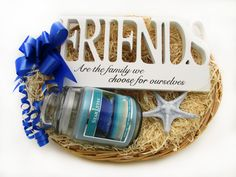 A beautiful 'Friends' shaped standing ornament and a scented soy candle in a glass jar with a lid make up this gorgeous Friends basket! Perfect for your best friends! Price: 19.99 http://luxuryhampers.ie/p/friends_basket