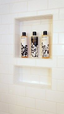 I like the shower niche/shelf in same tile and without a border. Prettier this way.