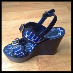"Tory Burch architectural wedge sandals Royal blue and white authentic Tory Burch wedge sandals. Perfect for spring/summer!! Features three gold tone buckles and stitched pattern. Measures 5"" tall with 2"" platform at the toe. Wear at the soles of shoes, and some wear on insoles. Tory Burch Shoes Wedges"