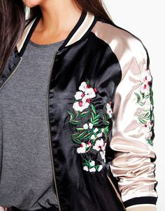 This is an ultimate bomber jacket from Boohoo, featuring embroidery detail to the front. This one is bound to be the season's biggest trend. Pair it with your favourite black dress or with jeans and a black top to add an edgy feel to your look.