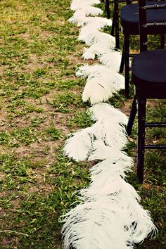 an idea...feathers as aisle borders #wedding #white#feathers